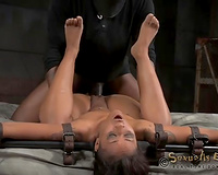 Dark skin skinny bitch on the filthy BDSM ottoman teamed up by 2 dudes