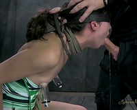 Slender fastened up brunette sits on chair and receives face hole banged