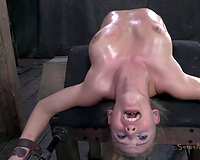 Oiled skinny pale golden-haired is thonged and bent over in advance of oral sex session