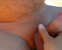 Lusty wife of my buddy sucked and kinda wanked his flaccid dick on the beach
