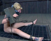 Blonde white bimbo gagged and put in biggest wooden pillory