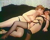 Frisky redhead lesbian babes are feeling up every other in arousing retro porn video