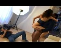 Porn behind the scenes includes interracial fucking