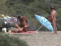 Amateur fucking at a nudist beach in the sand dunes people watching