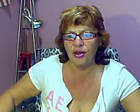 Depraved web camera mamma shows her large mambos and sucks a sextoy
