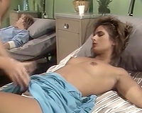 Two elegant classic white angels on the couch licking and fingering every other