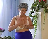 Insatiable granny with large love melons masturbates in her cozy bedroom