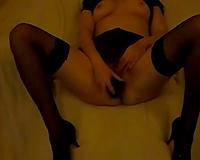 Stunning honey in dark nylon nylons enjoys masturbating her own pussy