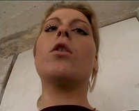 Dirty minded golden-haired floozy disrobes outdoors and gives tugjob