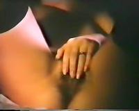 Cute brunette hair chick with dark nylons masturbates on the ottoman