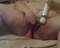 This unsightly and freaky old cheating wife masturbates with a vibrator
