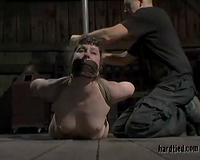 Brown-haired milf receives bound up and tortured in a basement