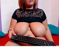 Redhead web camera milf shows her heavy scones and fingers her pussy