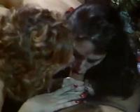 Retro dilettante porn movie scene of 2 older babes engulfing big pecker