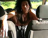 My sexually excited wife slams her wet crack with a gear stick in a car