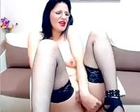 Pallid weird looking MILFie bitch in dark nylons was fingering herself