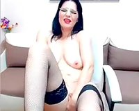 Pallid weird looking MILFie bitch in dark nylons was fingering herself
