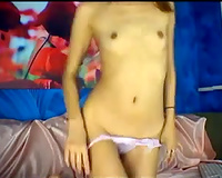 Skinny and playful babe on cam plays with her diminutive love tunnel