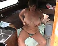 Busty milf in the daybed wearing hot bikini and flashing boobs