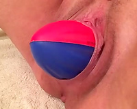 Dirty-minded wifey of my buddy pets her cum-hole with a diminutive ball