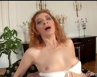 Old dissolute sweetheart loved to ride that big knob on ottoman