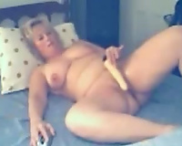 Blonde mommy can not help but groan whilst toying her love tunnel