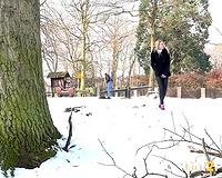 Blonde sweetie in dark thermal panties urinates in the park