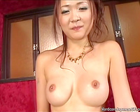 Cute and fresh Japanese wench with fake mambos teased with a vibrator