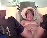 Mature mamma caresses her juicy snatch in front of the camera