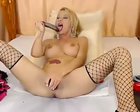Spectacular blond sexy model in fishnet nylons toys herself