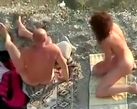 Swingers fucking ribald on a nudists beach outdoor in foursome