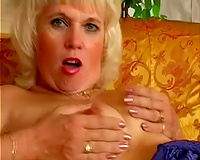 Mature whore finger fucks her chunky fur pie with great enthusiasm