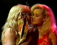 Two sexy and cute golden-haired retro gals making out with every other