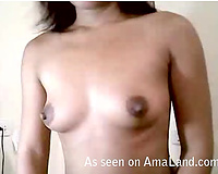 Amateur Asian sweetheart undresses and plays with her hairless pussy