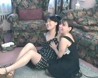 Two nerd women in dark attires take a part in a trio