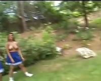Three breasty milf whores topless outside in the backyard