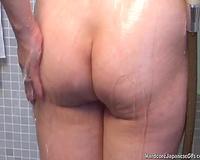 Slender Japanese milf in the shower room filmed bare