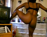 Slightly bulky swarthy babe shakes her ass and dance