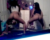 Two skanky Ebony student shake their asses during hawt dance