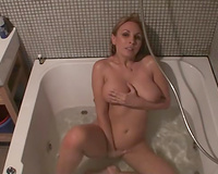 Busty white non-professional sweetie in the bathtub showing meatballs