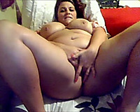 Big boobed honey fingering herself passionately in solo movie scene