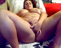 Big boobed honey fingering herself passionately in solo movie scene