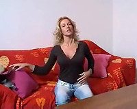 Alluring golden-haired haired mother I'd like to fuck in high boots stripteased before her solo show