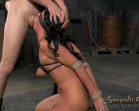 Tanned brunette hair with tied up hands acquires face hole drilled by corporalist
