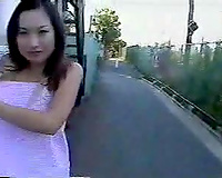 Sexy and slender Asian girlfriend outside nude playing