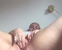 Pallid slutwife with quite big bum had a chance to please her pussy with a toy