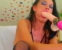Torrid lengthy haired brunette was engulfing her pink fake penis so passionately