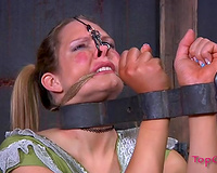 Blonde cute babe fixed in pillory and her nostrils pulled up