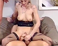 Two ballsy dudes group-sex short-haired thin blonde on the bed