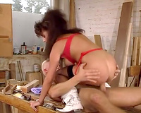 Wild and restless brunette hair chick riding bulky ramrod in the workshop
